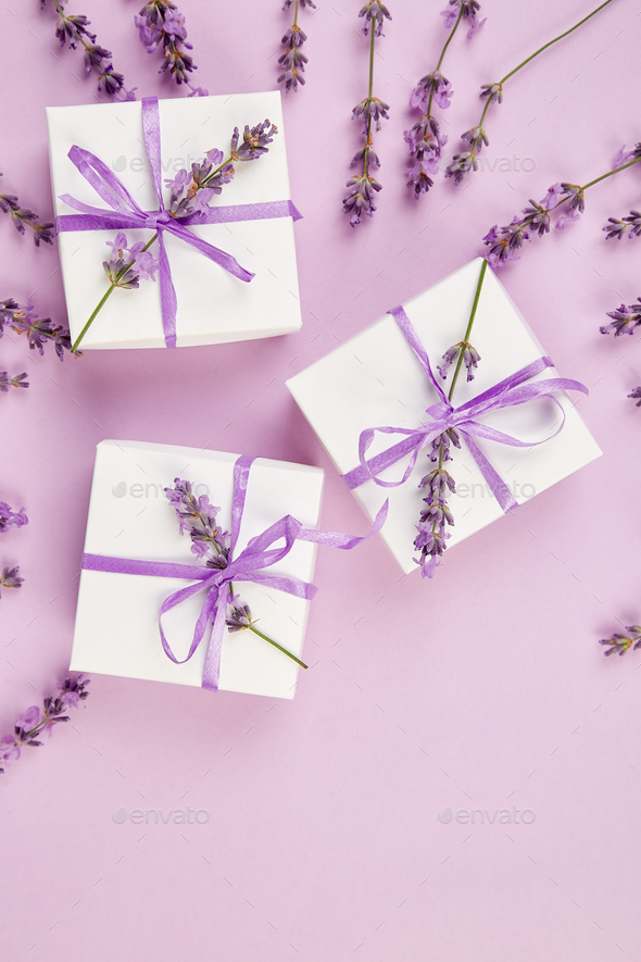 White Gift box with violet ribbon and lavender - Stock Photo - Images