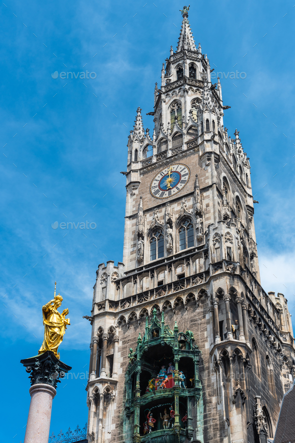 The Marian Column, Clock chimes and the tower of the New Town Hall - Stock Photo - Images