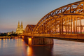 The illuminated Hohenzollern Bridge with the famous Cologne Cathedral - PhotoDune Item for Sale