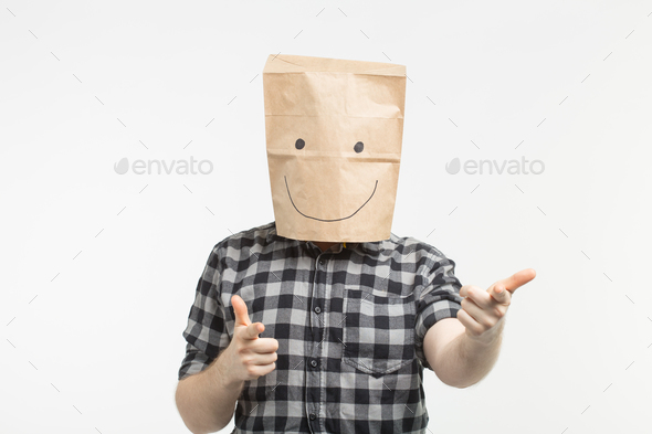 Portrait of man in happy paper bag mask on white background - Stock Photo - Images