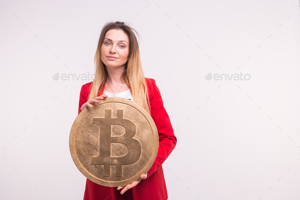 Freckled woman holding big bitcoin on white background. Cryptocurrency investment concept. - Stock Photo - Images