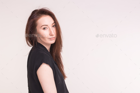 Young Asian pretty woman close up portrait on white background with copy space - Stock Photo - Images