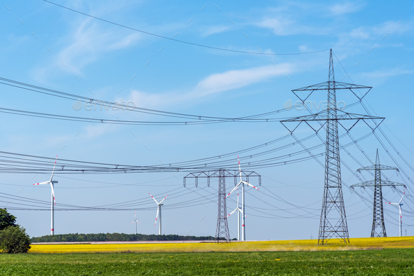 Power supply lines and some wind turbines - Stock Photo - Images