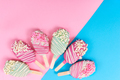 Different cake pops in form of popsicle on stick on pink and blu - PhotoDune Item for Sale