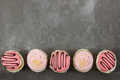 Strawberry cupcakes on gray stone background. - PhotoDune Item for Sale