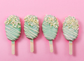 Various сake pops in form of popsicle on stick on pink backgrou - PhotoDune Item for Sale