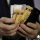 Solid Businessman Pulls Out the Euro and Swiss Francs From His  Wallet - VideoHive Item for Sale
