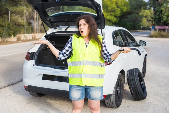 Woman waiting for emergancy assistance. Broken down car - Stock Photo - Images