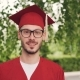 Portrait of Bearded Young Man Graduating Student Wearing Glasses, Graduation Gown and Mortar-board - VideoHive Item for Sale