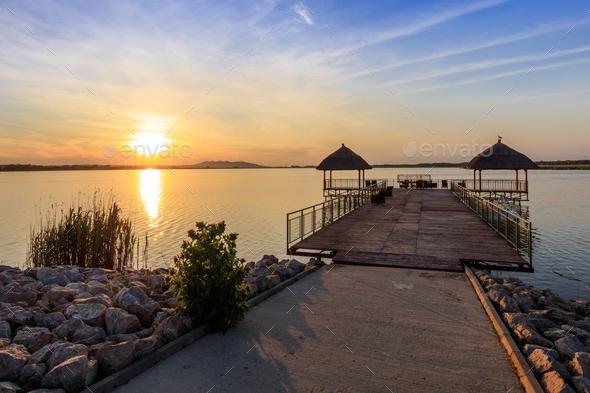 sunset over lake - Stock Photo - Images