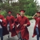 Cheerful Grads Running Together Under Rain Waving Diplomas and Laughing - VideoHive Item for Sale