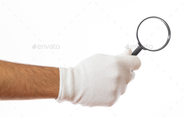 Search concept. Magnifying glass on a gloved hand palm isolated on white background, clipping path - Stock Photo - Images