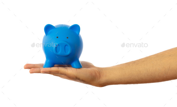 Piggy bank on a hand palm isolated on white background, clipping path - Stock Photo - Images