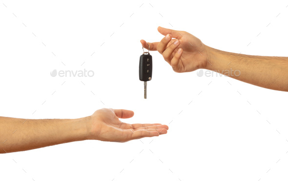 Handing over the car key. Hands isolated on white background, clipping path - Stock Photo - Images