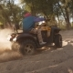 Man Riding Atv on Sand Picking Up Pillar of Dust. Modern Guy Driving Quadbike - VideoHive Item for Sale