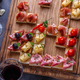 Close view of tiny spanish tapas with jamon, sausage, cheese and wine - PhotoDune Item for Sale