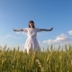 Beautiful Girl with Long Hair Whirls in Flight Stretching Out Her Hands and Smiling in Field with - VideoHive Item for Sale