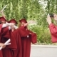 Young Man with Smartphone Is Taking Pictures of Graduates Having Fun Posing with Diplomas Moving - VideoHive Item for Sale