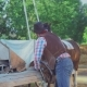Man Prepares a Horse for Riding - VideoHive Item for Sale