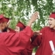 Excited Young Men and Women Graduates Are Doing High Five Embracing and Laughing - VideoHive Item for Sale