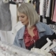 Shopping Girl. Portrait of a Beautiful Woman in the Clothes Store. Young Blonde Girl with Red Lips - VideoHive Item for Sale