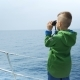Little Boy Stands on a Yacht and Looks in a Binocular - VideoHive Item for Sale