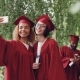 Pretty Female Graduates Are Taking Selfie with Diploma Scroll Using Smartphone, Young Women Are - VideoHive Item for Sale