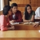 Students Are Discussing Team Project Sitting at Desks in University, Girls and Boys Are Talking - VideoHive Item for Sale