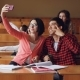 Cheerful Students Are Taking Selfie in Lecture Hall Sitting Together at Desks and Holding - VideoHive Item for Sale