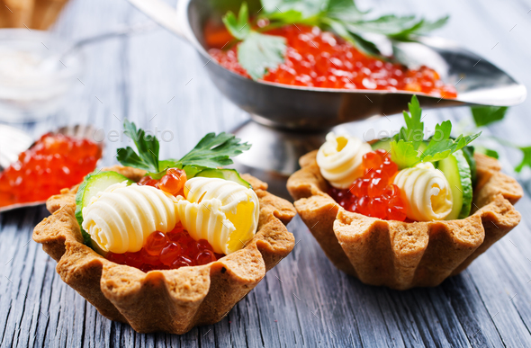 tartalets, butter and salmon caviar - Stock Photo - Images