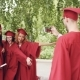 Graduating Student Is Recording Video of His Friends in Gowns Holding Diplomas, Waving Hands and - VideoHive Item for Sale