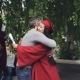 Loving Father Is Congratulating His Daughter on Graduation Day, People Are Hugging and Laughing - VideoHive Item for Sale