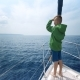 Little Boy Stands on the Bow of the Yacht and Shows the Way - VideoHive Item for Sale