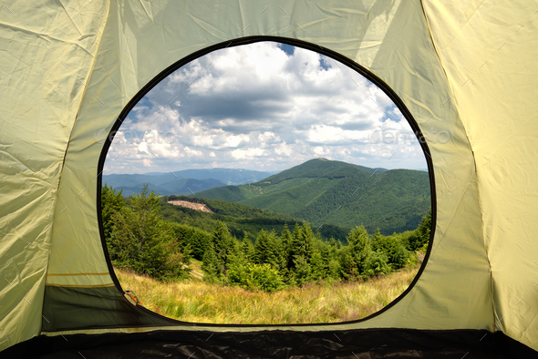 View from inside a tent on mountains landscape - Stock Photo - Images