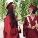 Fellow Students Are Talking and Laughing After Graduation Ceremony Holding Diplomae and Wearing - VideoHive Item for Sale