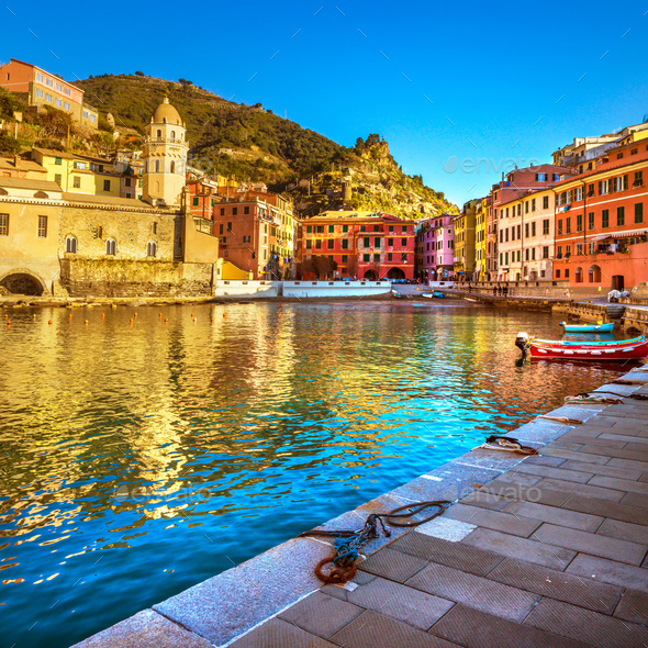 Vernazza village, church, boats and sea harbor on sunset. Cinque - Stock Photo - Images