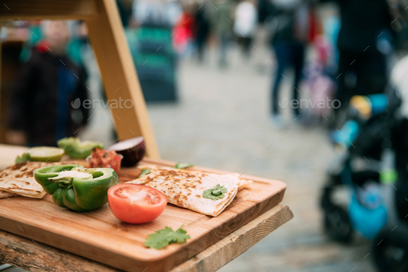 Tasty Pancakes And Vegetables Lie On The Wooden Board At A Festi - Stock Photo - Images
