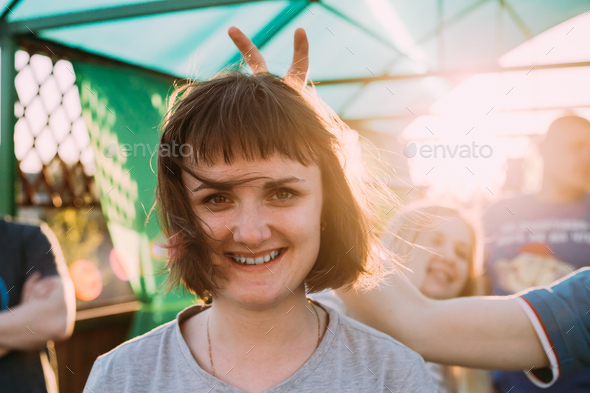 Young Adult Friends Having Fun Together. Young Caucasian Woman W - Stock Photo - Images