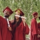 Two Students Are Taking Selfie with Graduation Diplomas Wearing Mortarboards and Gowns - VideoHive Item for Sale