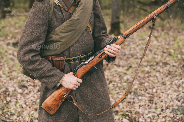 Russian Soviet Infantry Soldier Of World War II Holds Rifle Weap - Stock Photo - Images