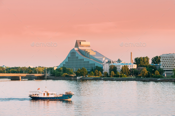 Riga, Latvia. Pleasure Boat Floating On Daugava River With View - Stock Photo - Images