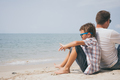 Portrait of young sad little boy and father sitting outdoors at - PhotoDune Item for Sale