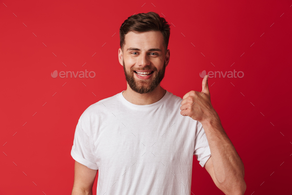 Happy young handsome man showing thumbs up. - Stock Photo - Images