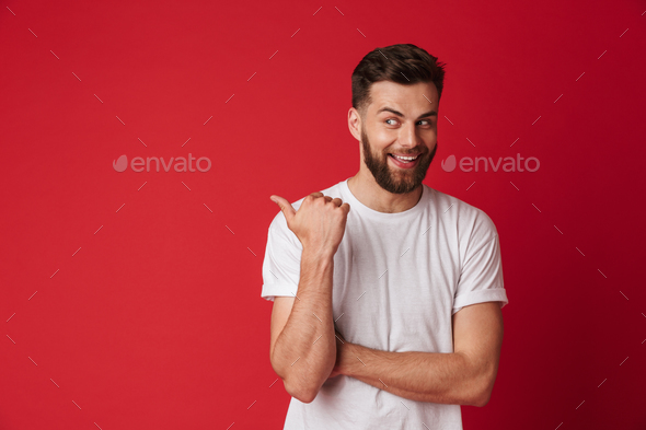Handsome young emotional man pointing. - Stock Photo - Images