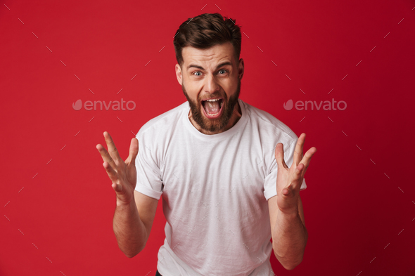 Angry emotional young man looking camera. - Stock Photo - Images