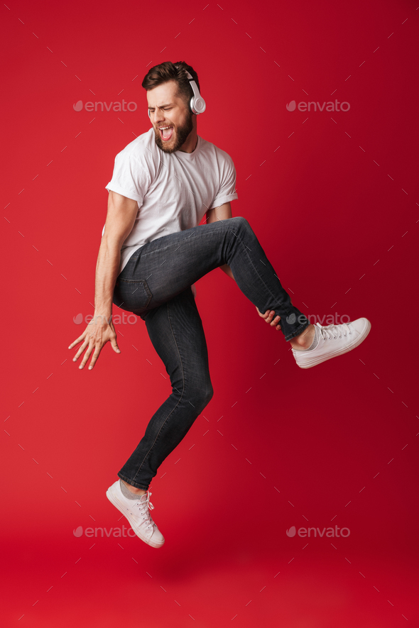 Emotional screaming young man isolated - Stock Photo - Images
