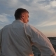 An Athlete in a Kimono Stands on Top of a Hill and Looks at the Sunset - VideoHive Item for Sale