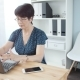 An Attractive Middle Aged Businesswoman with a Laptop in the Office - VideoHive Item for Sale