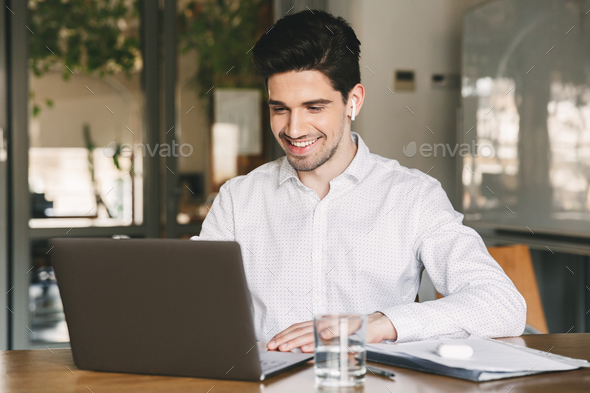 Image of handsome businessman wearing white shirt and modern ear - Stock Photo - Images