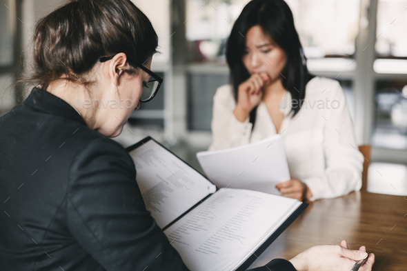 Photo from back of businesswoman interviewing, and talking with - Stock Photo - Images